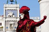 stock photo of venice carnival  - Mask in red at the Carnival of Venice - JPG
