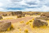 stock photo of urn funeral  - Funerary towers and ruins in Sillustani PeruSouth America - JPG