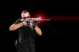 foto of gunshot  - Man aiming assault rifle laser sight - JPG