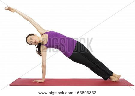 Woman In Side Plank Pose In Yoga