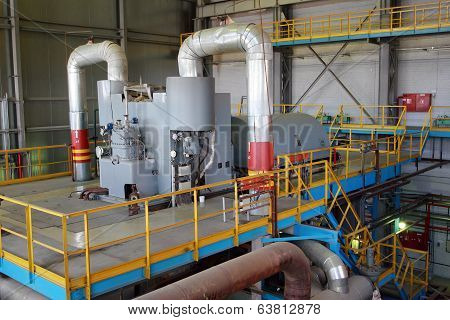 Steam Turbine Rotates Generator In The Turbine Hall