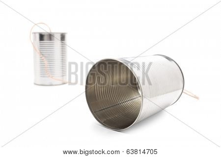 Tin can phone isolated on white background connected by a gray string