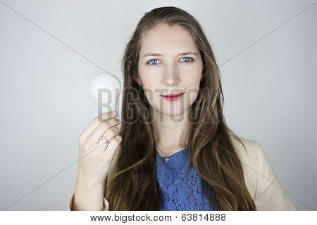 Woman holding unlit light bulb
