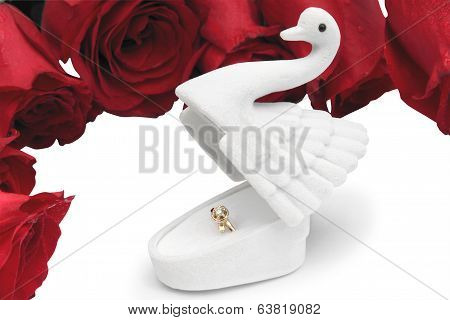 Gold Ring In A Box In The Form Of A Swan On Roses In Dewdrops