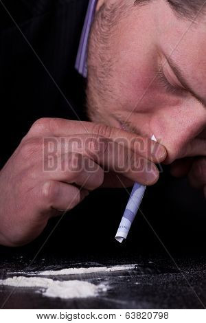 Man Taking Cocaine