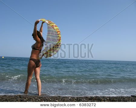 girl with scarf on beach