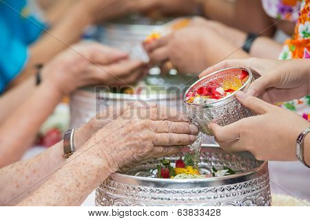 Pour Water On The Hands Of Revered Elders And Gives Blessing In Songkran Day