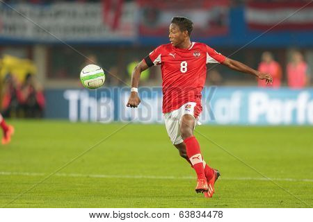 VIENNA,  AUSTRIA - JUNE  7 David Alaba (#8 Austria) kicks the ball during the world cup qualifier game on June 7, 2013 in Vienna, Austria.