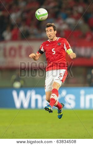 VIENNA,  AUSTRIA - JUNE  7  Christian Fuchs (#5 Austria) heads the ball during the world cup qualifier game on June 7, 2013 in Vienna, Austria.