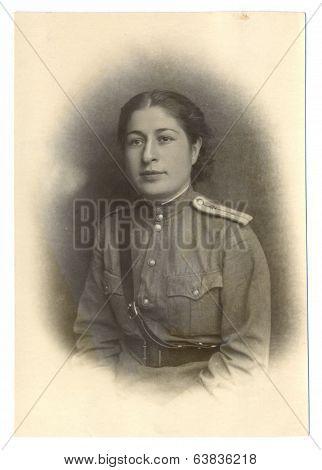 An antique studio photo of women lieutenant 1946 USSR