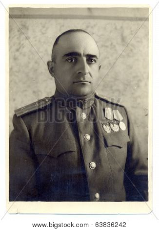 studio photo portrait of an aviation lieutenant Colonel of the Soviet Army