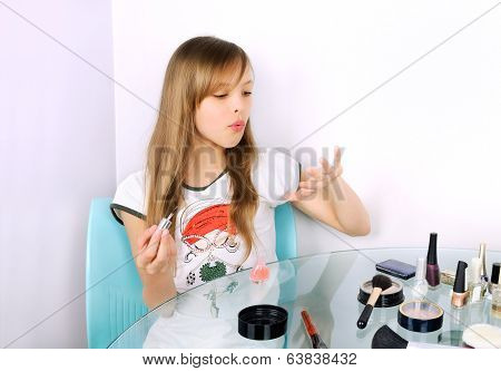 Teenager Girl Blowing On Painted Nails Horizontal