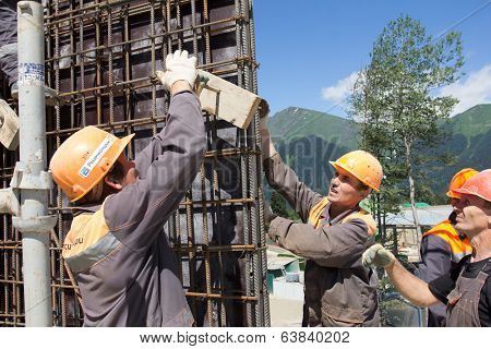 SOCHI, RUSSIA - JUNE 18, 2012: Workers make reinforcement for concrete wall