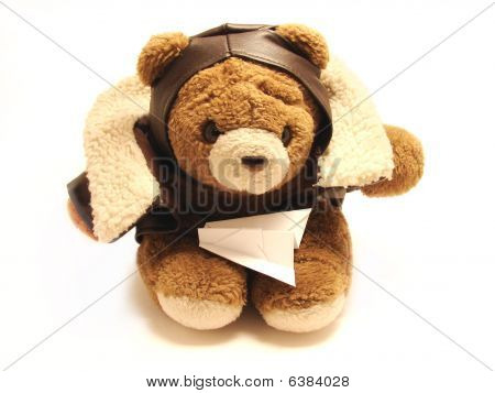 Teddy Bear Pilot With An Paper Airplane Isolated In A White Background