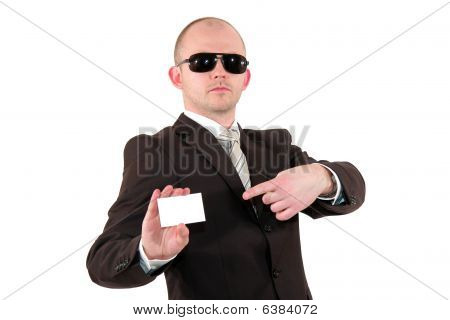 young business man with sunglasses pointing at business card