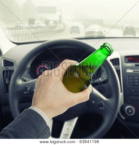 Man Holding Bottle Of Beer While Driving Car - 1 To 1 Ratio