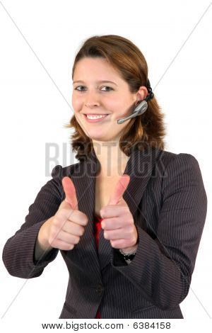 beautiful call center agent posing with the thumbs up sign