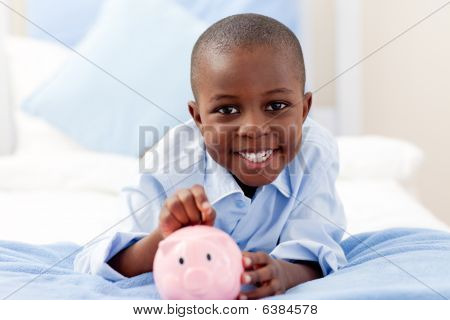 Young Boy Smiling At The Camera