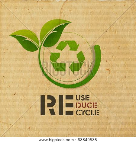 World Environment Day concept with illustration of recycle symbol and green leaves on grungy brown background.