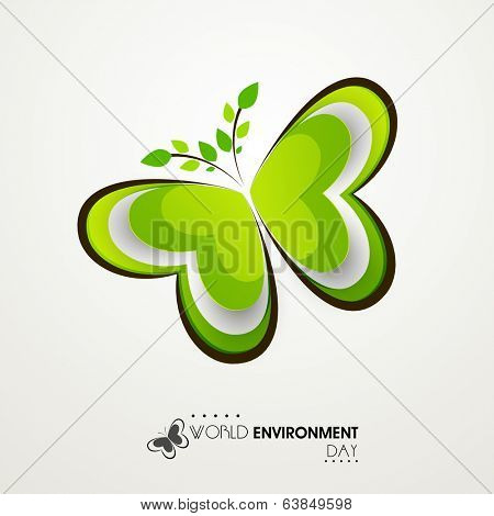Shiny beautiful green butterfly created by green leaves on grey background. Concept for World Environment Day background.