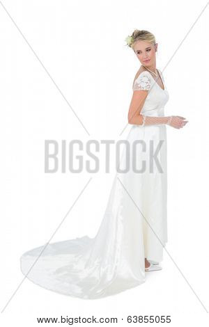 Full length of thoughtful bride looking over shoulder over white background