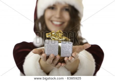 Smiling Young Santa Claus Woman Giving Christmas Gift