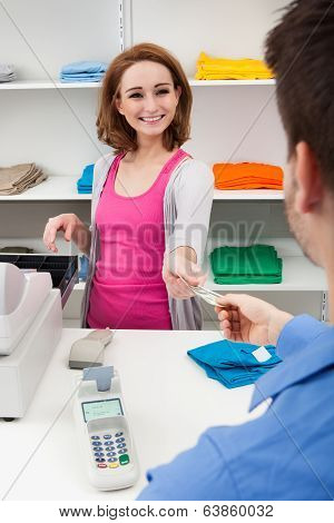 Client Handing Over Credit Card To A Cashier