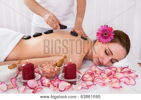 Happy Woman Getting Hot Stone Therapy