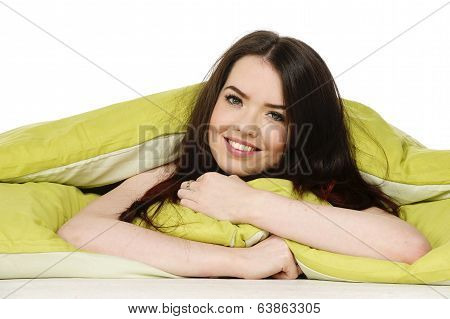 Woman Laid In A Green Bed Smiling