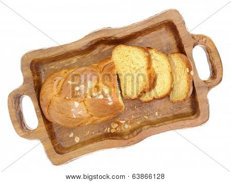 Sweet braided brioche bread on tray isolated on white