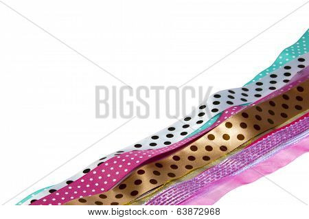 Row Of Spotted Multicolored Ribbons On White