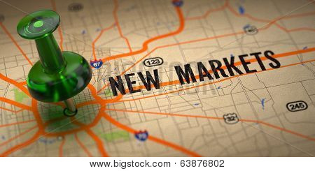 New Markets - Green Pushpin on a Map Background.