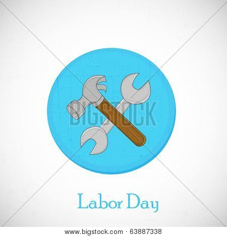 Sticker, tag or label design for World Labor Day with working tools, hammer and wrench on grey background.