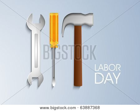 World Labor Day concept with working tools, wrench, screw driver and hammer on blue background.