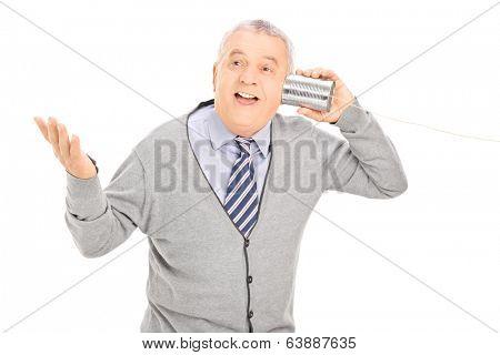 Senior talking through a tin can phone isolated on white background