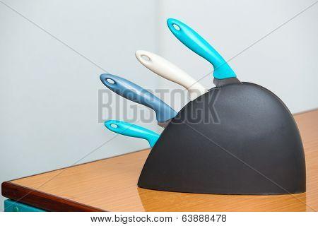 Multicoloured knife rack on kitchen table