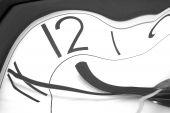 picture of albert einstein  - physics of time shown by warped watch - JPG