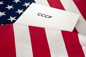 stock photo of cold-war  - cold war  USA and USSR, CCCP written on the book, flag baground