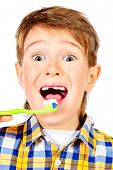 stock photo of prophylactic  - Little funny boy smiling and brushing his teeth - JPG