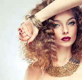 stock photo of jewelry  - Model curly hair and the red manicure - JPG