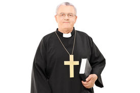 stock photo of priest  - Mature priest holding a bible isolated on white background - JPG