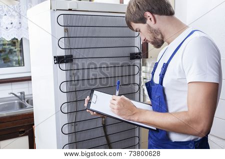 Handyman During Fridge Repair