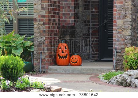 Pumpkins and other decorations near a house