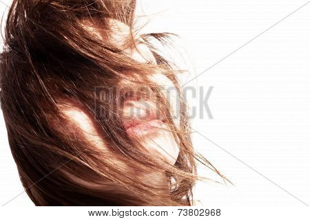 Young Woman With Hair In The Wind