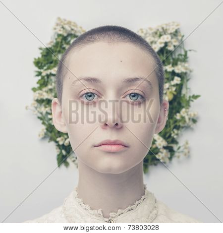 beautiful bald-headed girl over floral background