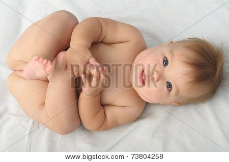 Cute Baby Holding Her Leg