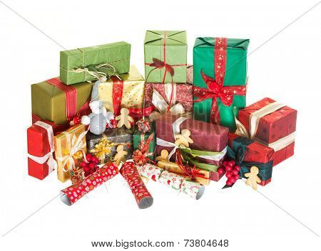 Abundance of piled christmas presents crackers and gingerbread men