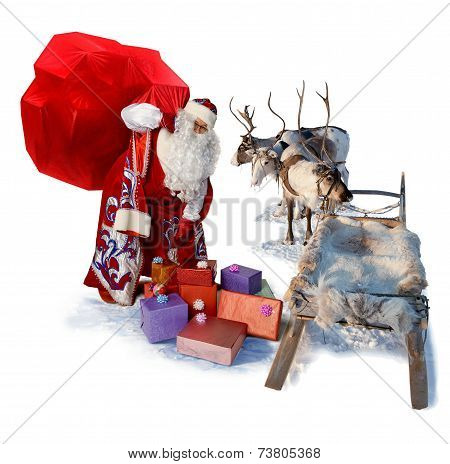 Santa Claus With Big Bag Of Gifts And His Reindeer Sleigh