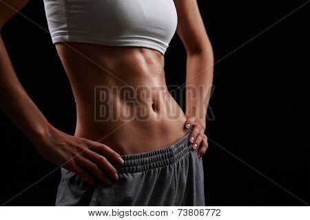 Wet female body in activewear