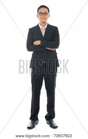 Full length pan Asian businessman crossed arms standing isolated on white background.
